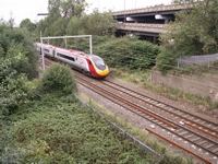 Virgin Pendolino thunders through the site of Wood Green station