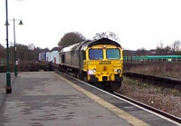 66543 pulls freight through Olton